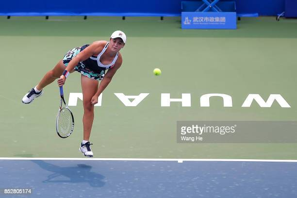 Ashleigh Barty of Australia serves against Catherine Bellis of USA during 2017 Dongfeng Motor Wuhan Open at Optics Valley International Tennis Center...