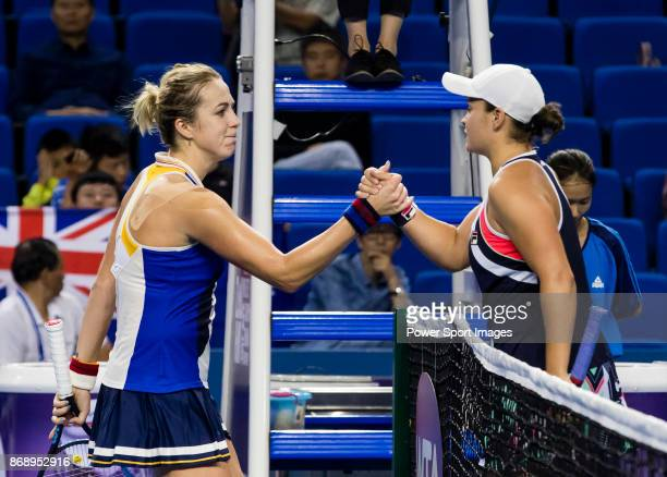 Ashleigh Barty of Australia shakes hand with Anastasia Pavlyuchenkova of Russia after winning the singles Round Robin match of the WTA Elite Trophy...