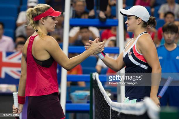 Ashleigh Barty of Australia shakes hand with Angelique Kerber of Germany after winning the singles Round Robin match of the WTA Elite Trophy Zhuhai...