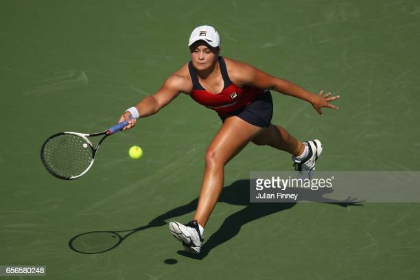 Ashleigh Barty of Australia stretches for a forehand in her match against Eugenie Bouchard of Canada at Crandon Park Tennis Center on March 22 2017...