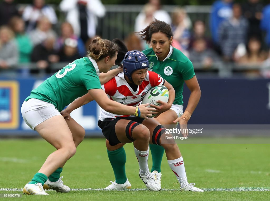 Ashleigh Baxter of Ireland is tackled by Maki Takano of Japan during the Women's Rugby World Cup 2017 match between Ireland and Japan on August 13, 2017 in Dublin, Ireland.