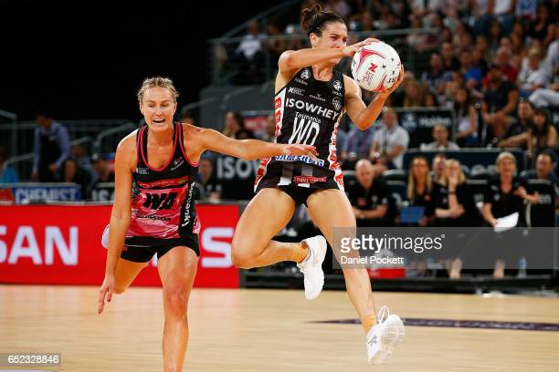 Ashleigh Brazill of the Magpies and Chelsea Pitman of the Thunderbirds contest the ball during the round four Super Netball match between the Magpies...