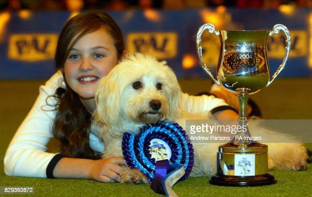 Ashleigh Butler 9 from Wellingborough Northants with Buffy a Border Bichon Fise Collier celebrates after winning the Pal Scrufts CrossBreed of the...