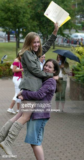 Ashleigh Collins gets a lift from friend Emma Morgarab after she got 11A*s at GCSE level and Emma got 8A *s at Emmanuel Collage in Gateshead Tyne and...