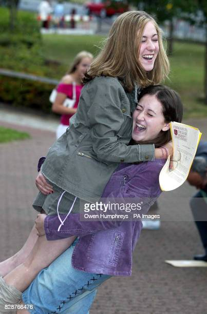 Ashleigh Collins gets a lift from friend Emma Morgarab after she got 11A*'s at GCSE level with Emma getting 8A*'s at Emmanuel Collage in Gateshead...