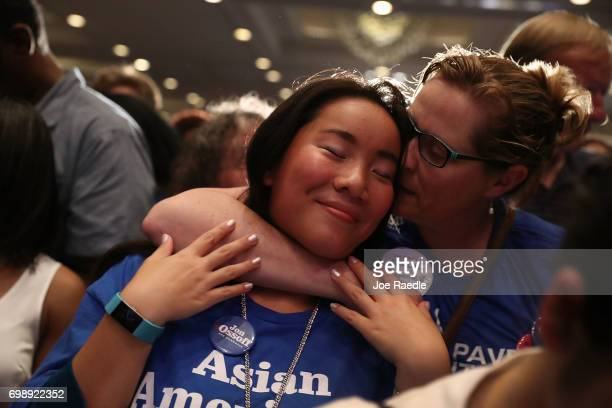 Ashleigh Ewald is hugged by her mother Lori Ewald as vote results show Democratic candidate Jon Ossoff losing to his challenger during his election...