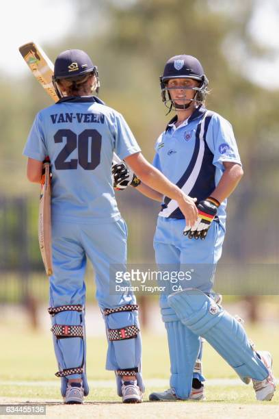 Ashleigh Gardner of New South Wales raises his bat after scoring 50 runs during the National Indigenous Cricket Championships match between New South...