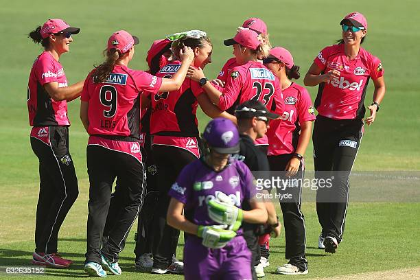 Ashleigh Gardner of the Sixers celebrates with team mates after dismissing Hayley Matthews of the Hurricanes during the Women's Big Bash League semi...
