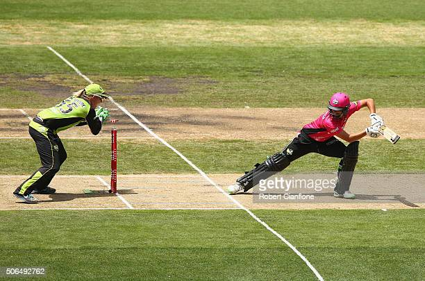 Ashleigh Gardner of the Sixers is stumped by Claire Koski of the Thunder during the Women's Big Bash League Final match between the Sydney Thunder...