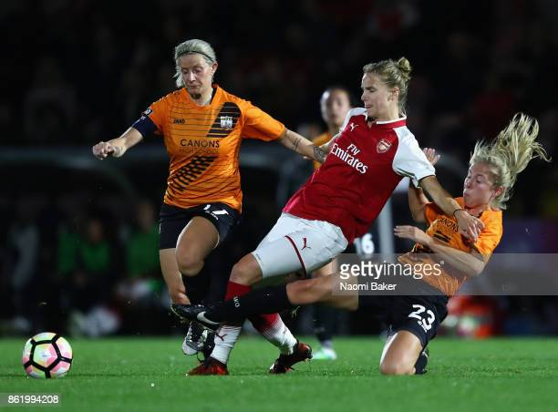 Ashleigh Goddard of London Bees and Emma Beckett of London Bees tackles Vivianne Miedema of Arsenal during the FA Women's Super League Continental...