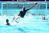 Ashleigh Johnson of the United States makes a save on a shot from Ash Southern of Australia during the 2016 Olympic team trials at the Uytengsu...
