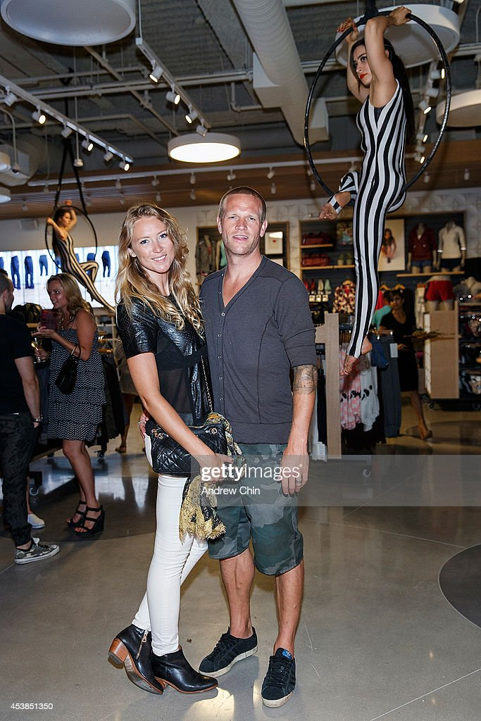 <a gi-track='captionPersonalityLinkClicked' href=/galleries/search?phrase=Ashleigh+McIvor&family=editorial&specificpeople=790123 ng-click='$event.stopPropagation()'>Ashleigh McIvor</a> and Jay DeMerrit attend the Lululemon Athletica flagship store opening party at 970 Robson Street on August 19, 2014 in Vancouver, Canada.