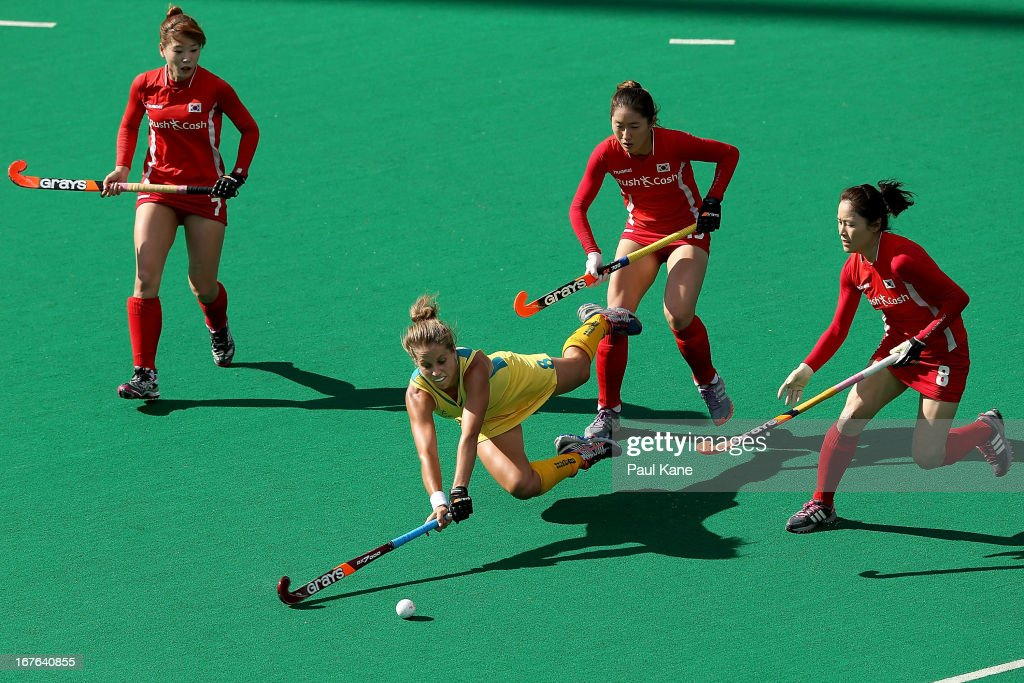 Ashleigh Nelson of Australia dives for the ball against Cha Se Na, An Hyo Ju and Kim Jong Hee of Korea during the International Test match between the Australian Hockeyroos and Korea at Perth Hockey Stadium on April 27, 2013 in Perth, Australia.
