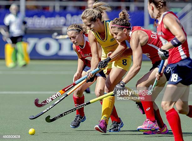 Ashleigh Nelson of Australia vies for the ball Katie O'Donnell of the US during a stage match between the United States and Australia in the women's...