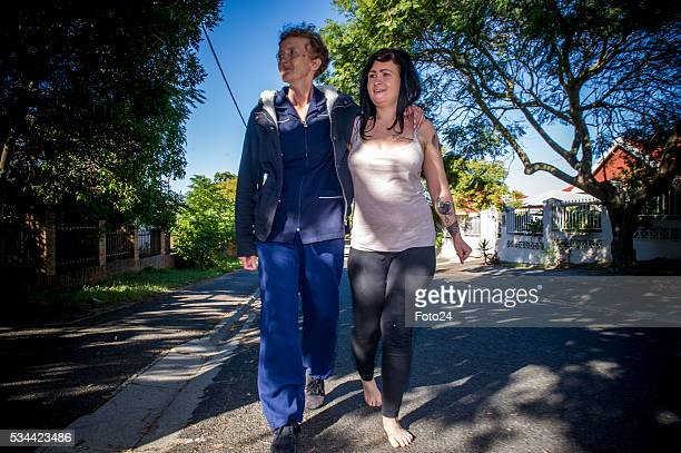 Ashleigh Schultz the Obz Café waitress who fell victim to alleged racism by a customer poses with her mother Cheryl Grundlingh during an interview on...