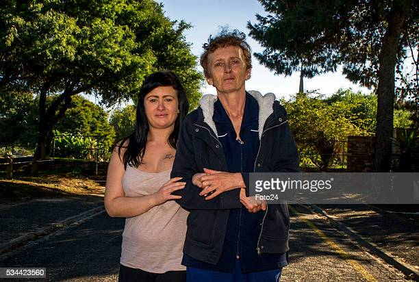 Ashleigh Schultz the Obz Café waitress who fell victim to alleged racism by a customer walks with her mother Cheryl Grundlingh during an interview on...