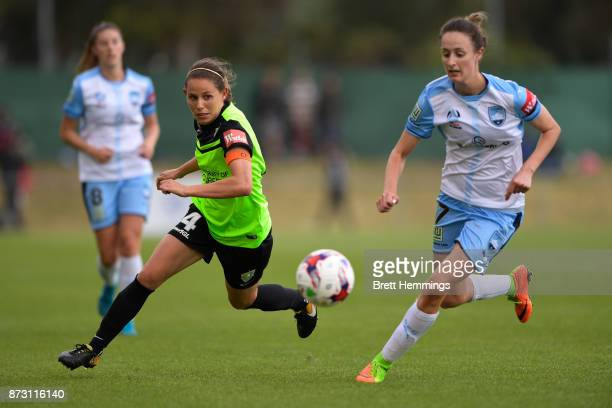 Ashleigh Sykes of Canberra and Rachel Soutar of Sydney contest the ball during the round three WLeague match between Canberra United and Sydney FC at...