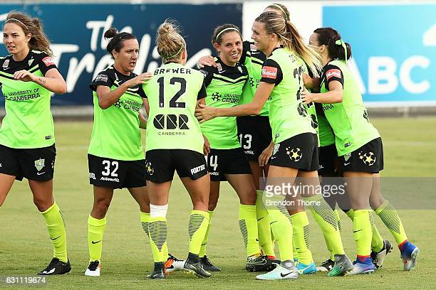 Ashleigh Sykes of Canberra celebrates with team mates after scoring a goal during the round 11 WLeague match between Canberra United and Adelaide...