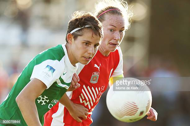 Ashleigh Sykes of Canberra competes for the ball with Elizabeth Milne of Adelaide during the round 14 WLeague match between Adelaide United and...