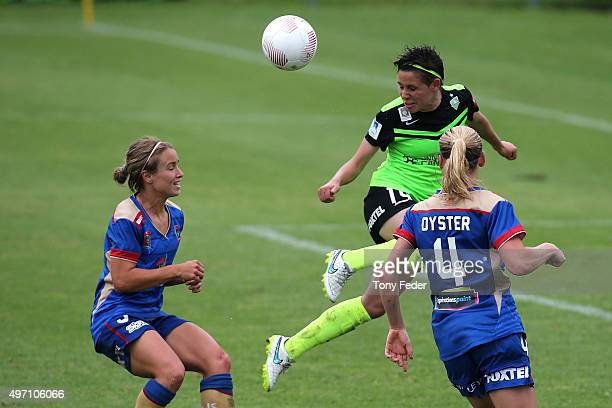Ashleigh Sykes of Canberra heads the ball during the round five WLeague match between the Newcastle Jets and Canberra United at Magic Park on...