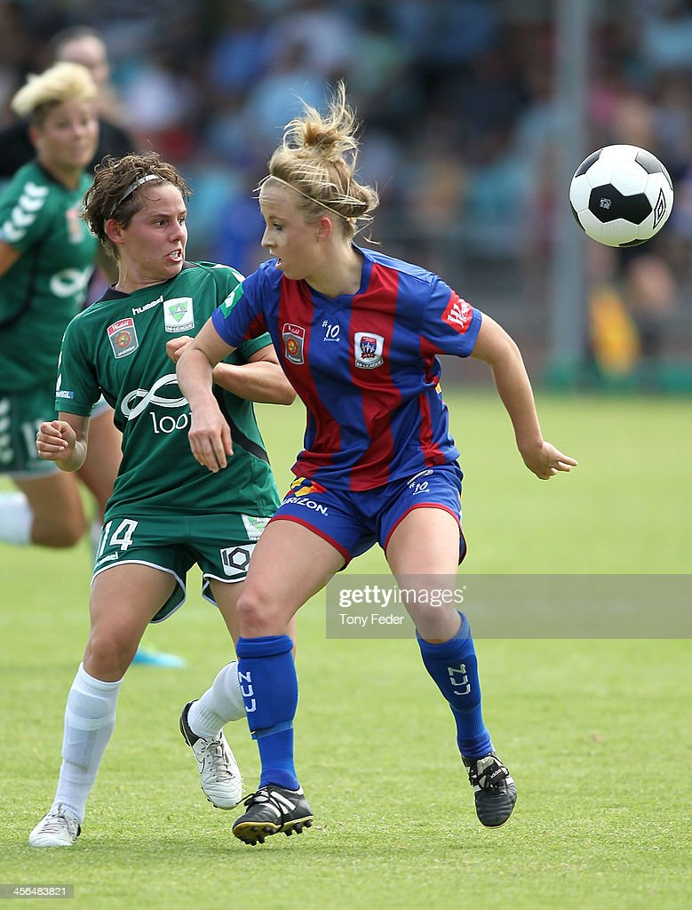 Ashleigh Sykes of Canberra United contests the ball against Hannah Brewer of the Jets during the round five W-League match between the Newcastle Jets and Canberra United at Wanderers Oval on December 14, 2013 in Newcastle, Australia.