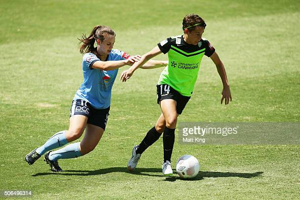 Ashleigh Sykes of Canberra United is challenged by Natalie Tobin of Sydney FC during the WLeague semi final match between Canberra United and Sydney...