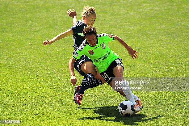 Ashleigh Sykes of United controls the ball under pressure from Elli Reed of the Victory during the WLeague Semi Final match between Melbourne Victory...