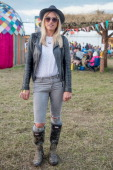 Ashley 26 from London wearing Topshop jeans hunter Wellies a custom jacket and vintage on day 3 at the Glastonbury Festival at Worthy Farm on June 29...