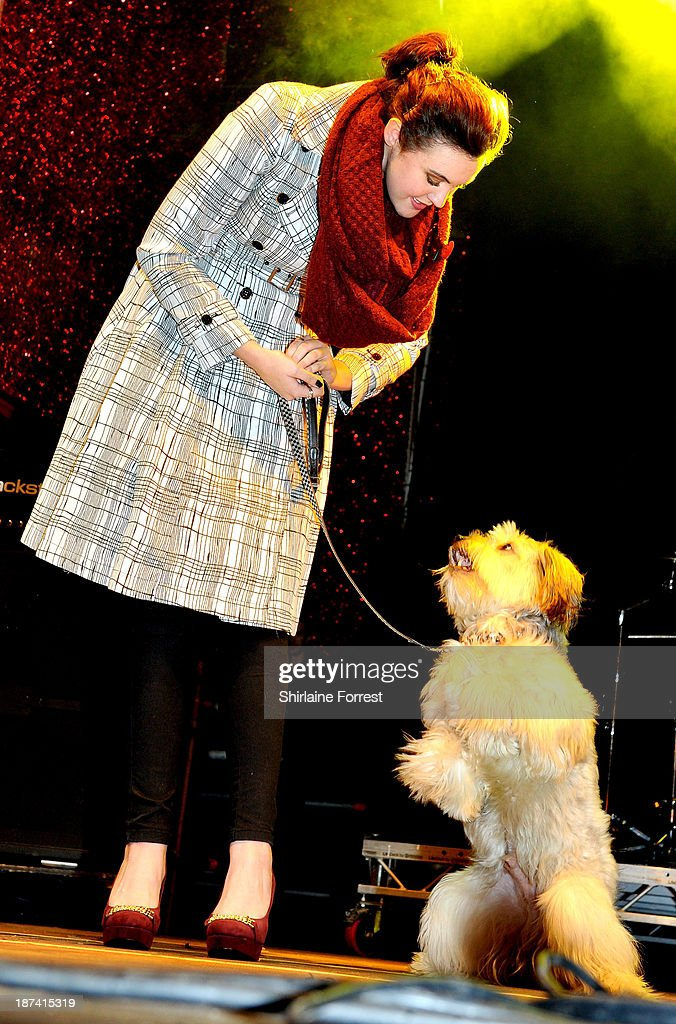 Ashley and Pudsey onstage at the switch on of the Manchester Christmas lights at Albert Square on November 8, 2013 in Manchester, England.