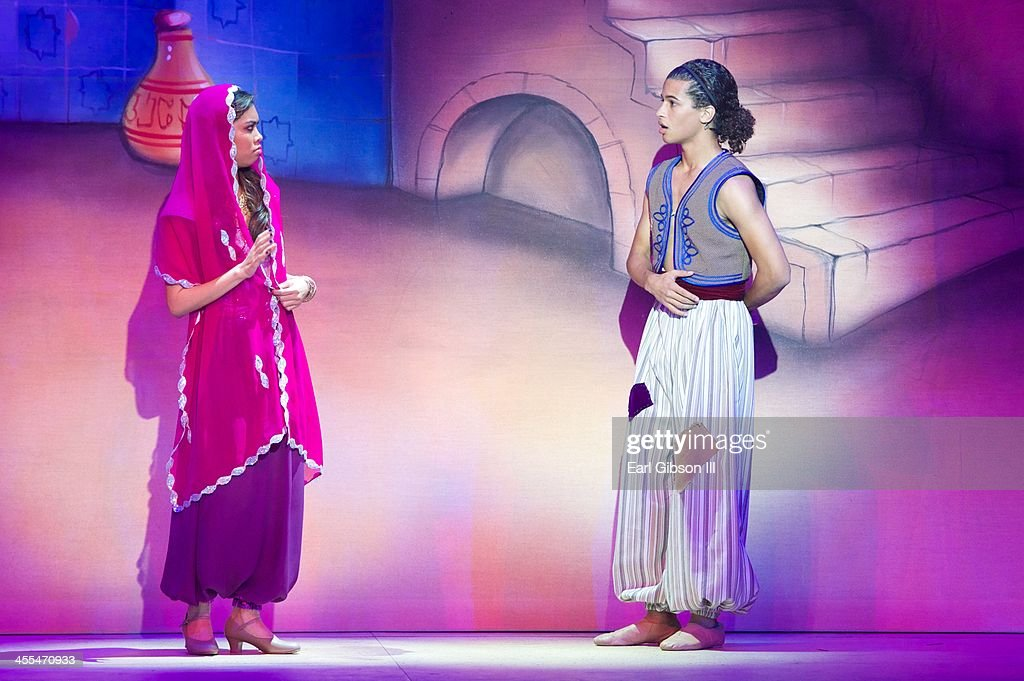 <a gi-track='captionPersonalityLinkClicked' href=/galleries/search?phrase=Ashley+Argota&family=editorial&specificpeople=5626349 ng-click='$event.stopPropagation()'>Ashley Argota</a> and Jordan Fisher perform in 'Aladdin And His Winter Wish' Opening Night at Pasadena Playhouse on December 11, 2013 in Pasadena, California.