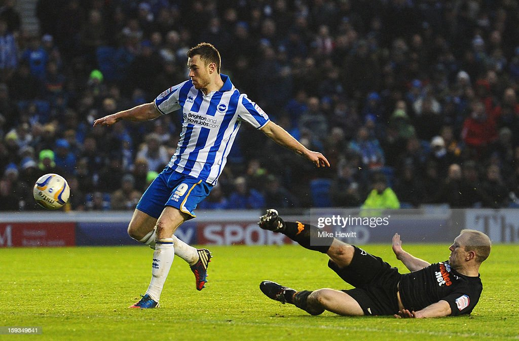 Ashley Barnes of Brighton gets past Gareth Roberts of Derby during the npower Championship match between Brighton & Hove Albion and Derby County at Amex Stadium on January 12, 2013 in Brighton, England.