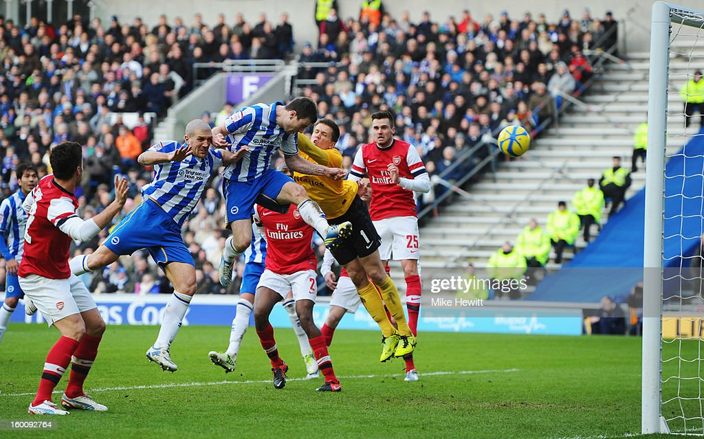 Ashley Barnes of Brighton & Hove Albion beats goalkeeper <a gi-track='captionPersonalityLinkClicked' href=/galleries/search?phrase=Wojciech+Szczesny&family=editorial&specificpeople=6539507 ng-click='$event.stopPropagation()'>Wojciech Szczesny</a> of Arsenal to score their first goal during the FA Cup with Budweiser Fourth Round match between Brighton & Hove Albion and Arsenal at Amex Stadium on January 26, 2013 in Brighton, England.