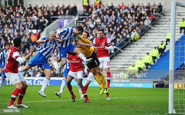 Ashley Barnes of Brighton Hove Albion beats goalkeeper Wojciech Szczesny of Arsenal to score their first goal during the FA Cup with Budweiser Fourth...