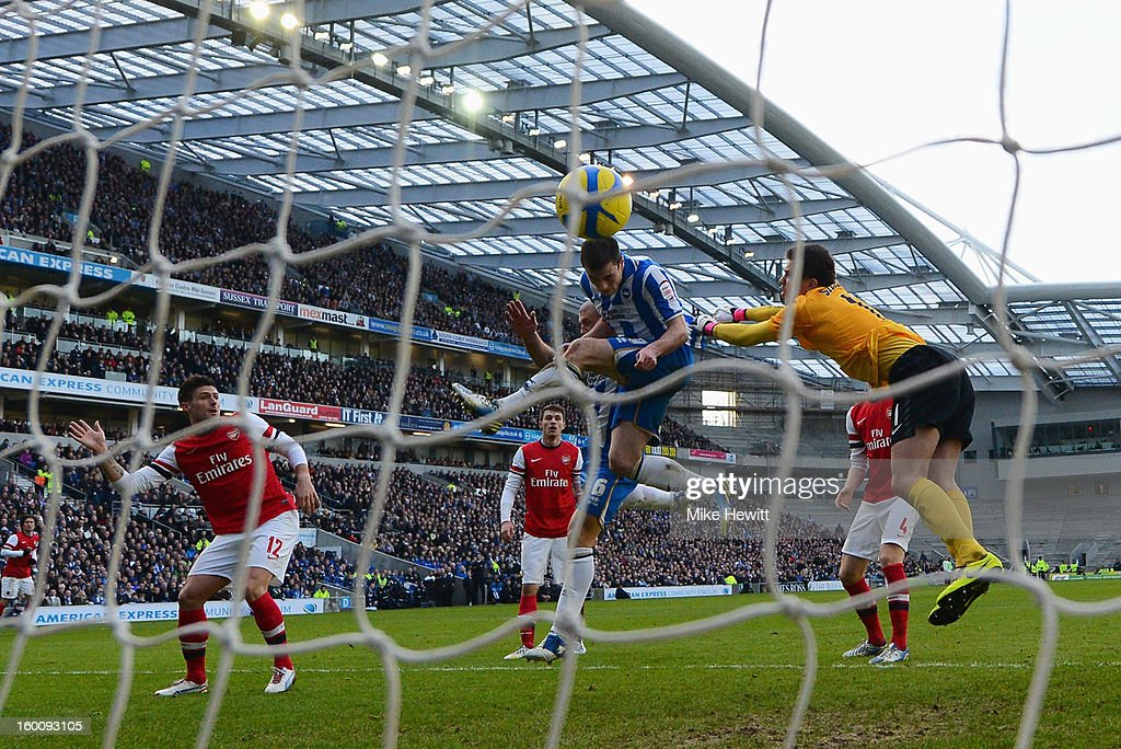 Ashley Barnes of Brighton & Hove Albion beats goalkeeper Wojciech Szczesny of Arsenal to score their first goal during the FA Cup with Budweiser Fourth Round match between Brighton & Hove Albion and Arsenal at Amex Stadium on January 26, 2013 in Brighton, England.