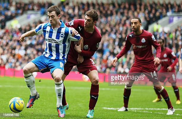 Ashley Barnes of Brighton Hove Albion holds off Davide Stanton of Newcastle United during the FA Cup with Budweiser Third Round match between...