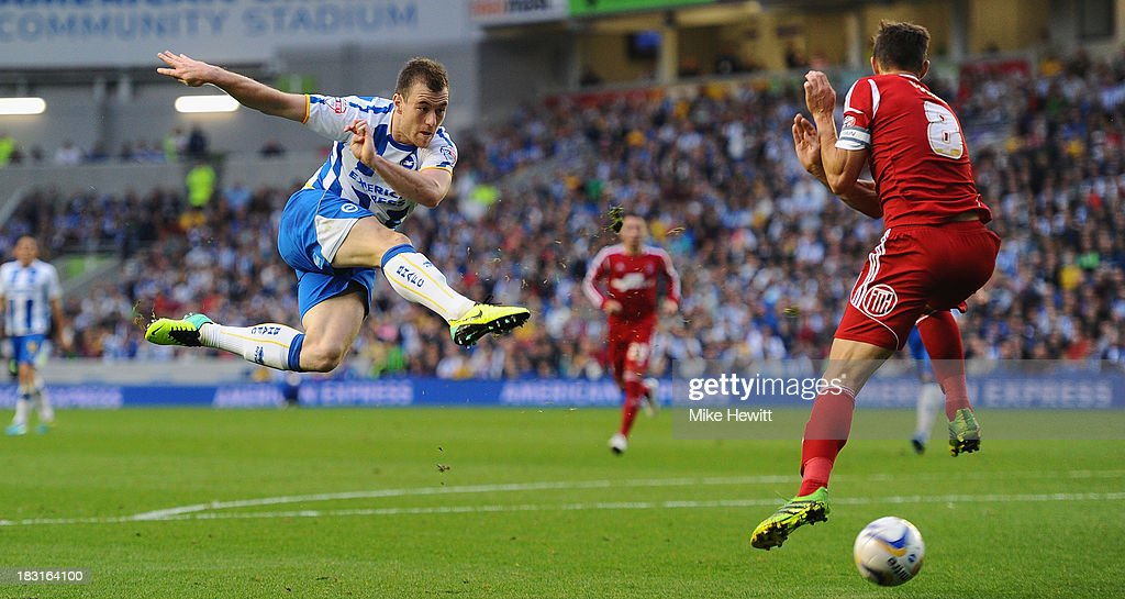 Ashley Barnes of Brighton tries a flying volley as Chris Cohen of Nottingham Forest takes evasive action during the Sky Bet Championship match between Brighton & Hove Albion and Nottingham Forest at Amex Stadium on October 5, 2013 in Brighton, England.
