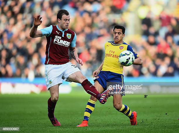 Ashley Barnes of Burnley and Alexis Sanchez of Arsenal battle for the ball during the Barclays Premier League match between Burnley and Arsenal at...