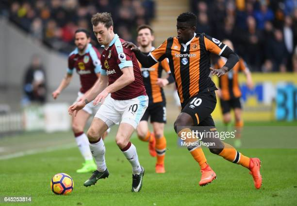 Ashley Barnes of Burnley and Alfred N'Diaye of Hull City battle for possession during the Premier League match between Hull City and Burnley at KCOM...