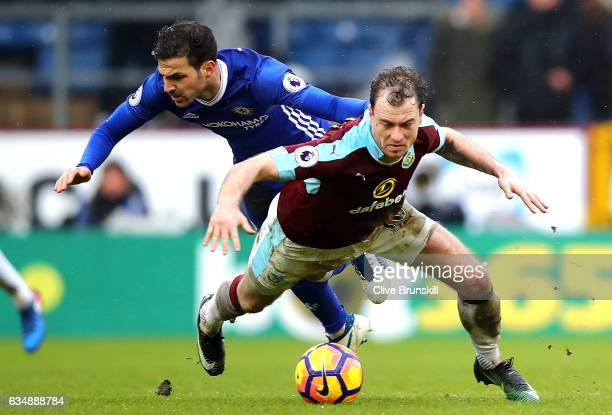 Ashley Barnes of Burnley and Cesc Fabregas of Chelsea in action during the Premier League match between Burnley and Chelsea at Turf Moor on February...