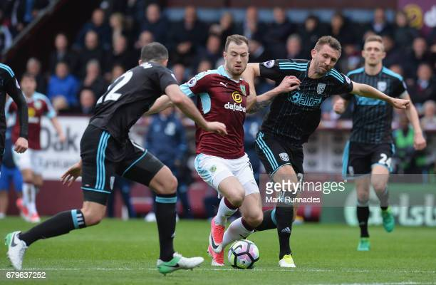 Ashley Barnes of Burnley and Gareth McAuley of West Bromwich Albion battle for possession during the Premier League match between Burnley and West...