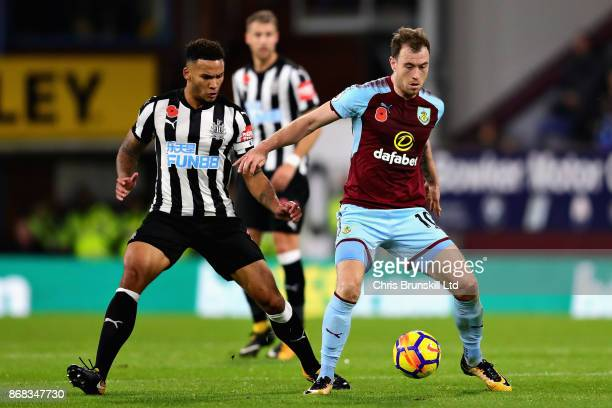 Ashley Barnes of Burnley ans Jamaal Lascelles of Newcastle United in action during the Premier League match between Burnley and Newcastle United at...