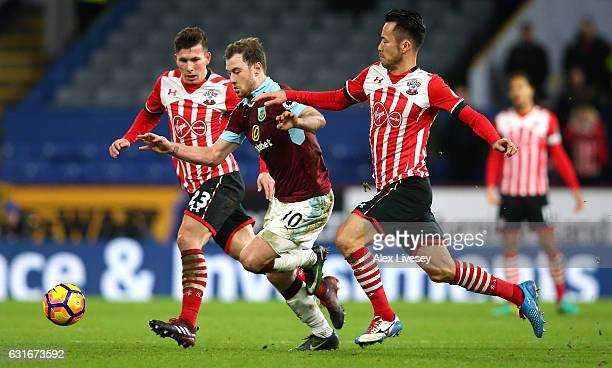 Ashley Barnes of Burnley attempts to get away from PierreEmile Hojbjerg of Southampton and Maya Yoshida of Southampton during the Premier League...