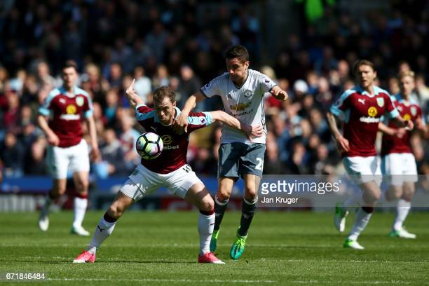 Ashley Barnes of Burnley battles for the ball with Ander Herrera of Manchester United during the Premier League match between Burnley and Manchester...