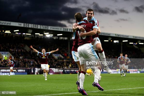 Ashley Barnes of Burnley celebrates scoring his sides third goal with Jon Flanagan of Burnley during the Premier League match between Burnley and...