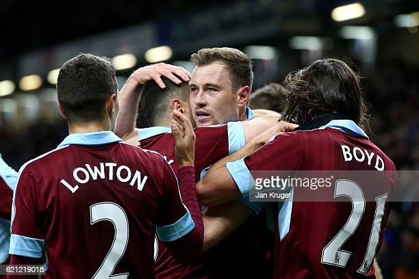 Ashley Barnes of Burnley celebrates scoring his sides third goal with his Burnley team mates during the Premier League match between Burnley and...