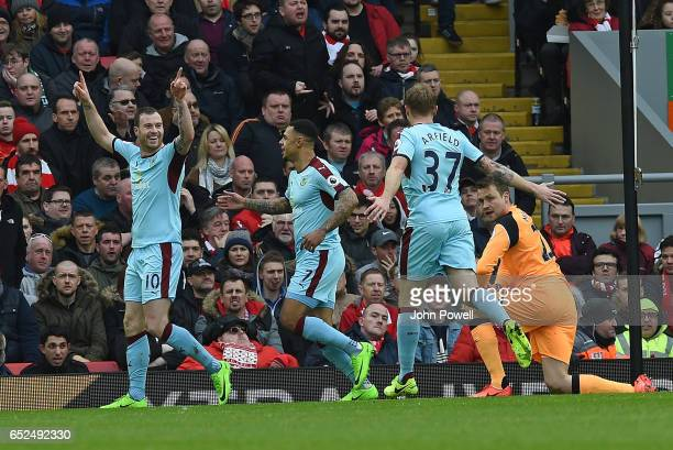 Ashley Barnes of Burnley scores the first and celebrates during the Premier League match between Liverpool and Burnley at Anfield on March 12 2017 in...