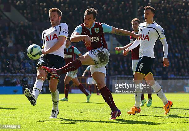 Ashley Barnes of Burnley shoots under pressure from Eric Dier of Spurs during the Barclays Premier League match between Burnley and Tottenham Hotspur...