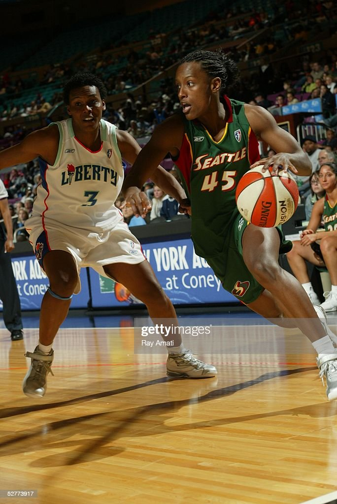 Ashley Battle of the Seattle Storm drives past Crystal Robinson of the New York Liberty during the Seattle Storm vs the New York Liberty game on May...
