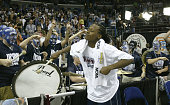 Ashley Battle of the University of Connecticut Huskies celebrates with the band after defeating the Tennessee Lady Vols 7061 in the National...