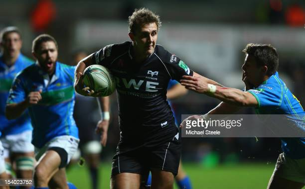 Ashley Beck of Ospreys holds off Tommaso Benvenuti of Benetton Rugby Treviso to score his sides final try during the Heineken Cup Pool Two match...